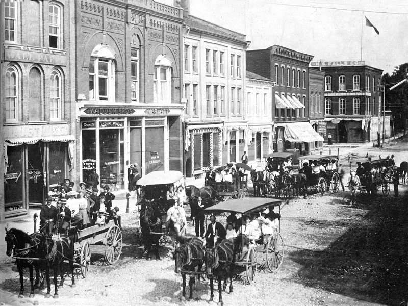 West side of Norfolk St., Simcoe, looking north, H.S. Falls Department Store in the background, circa, 1898.