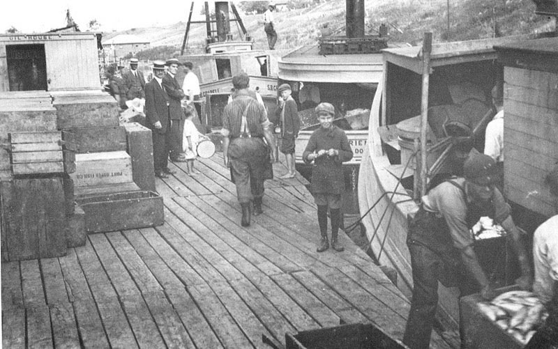 Fisherman unloading their catches at the Kolbe Docks in Port Dover. 1914